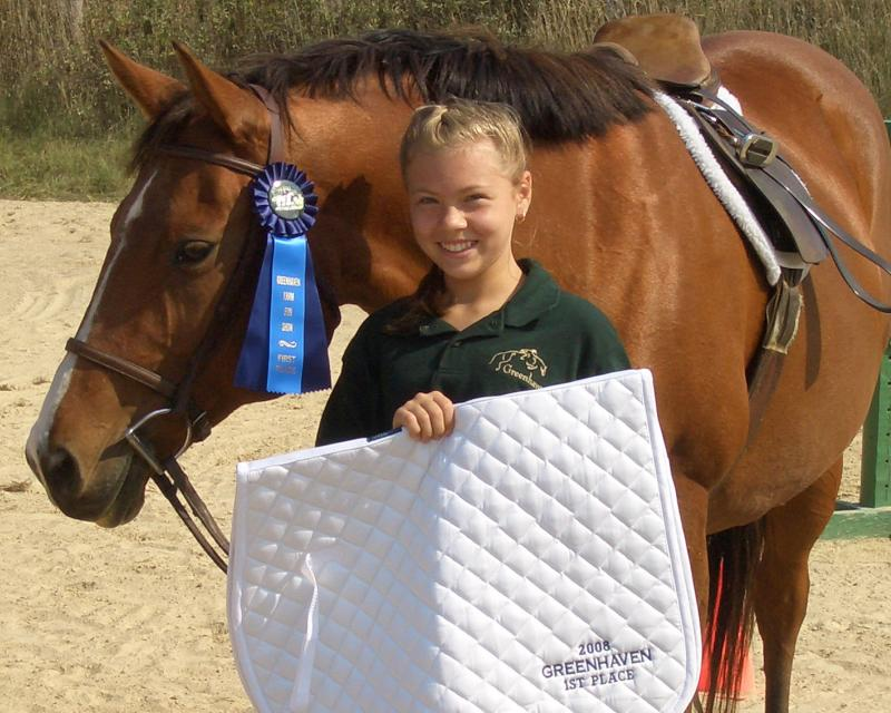 Maggie and a happy student showing off their awards at Fun Show.